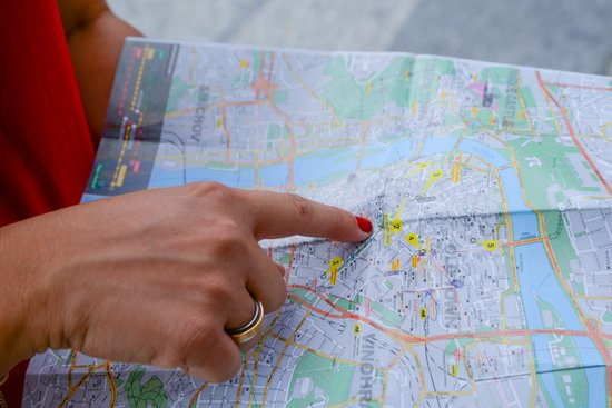 Tourist reading map for possible route.